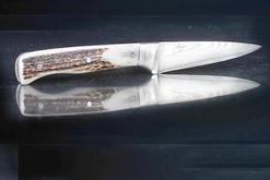 Steiger Messer und Manschettenknöpfe